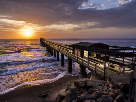 Namibia, Swakopmund, wooden boardwalk at sunset - AMF004638