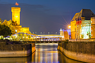 Germany, Cologne, Rheinauhafen, Malakoff Tower and Imhoff chocolate museum at blue hour - WGF000825