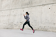 Spain, Barcelona, jogging woman - EBSF001209