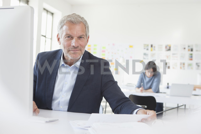 Portrait of confident businessman in office - RBF003987