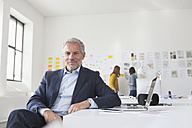 Portrait of confident businessman in office - RBF004056