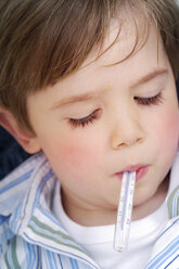 Portrait of little boy with clinical thermometer in his mouth - GUFF000219