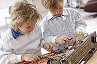 Two little boys disassembling an old radio - GUFF000222
