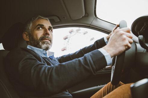 Austria, Vienna, portrait of man driving car - AIF000232