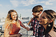 Austria, Vienna, Young people having a party on rooftop terrace - AIF000235