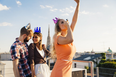Austria, Vienna, Young people having a party on rooftop terrace - AIF000247