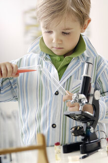 Portrait of little boy with test tubes and microscope - GUFF000243