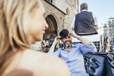 Austria, Vienna, couple having fun on sightseeing tour in a fiaker - AIF000282