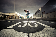 Spain, Tenerife, boy skating on a road - SIPF000049