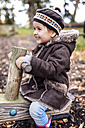 Happy little girl on a playground in autumn - MGOF001238