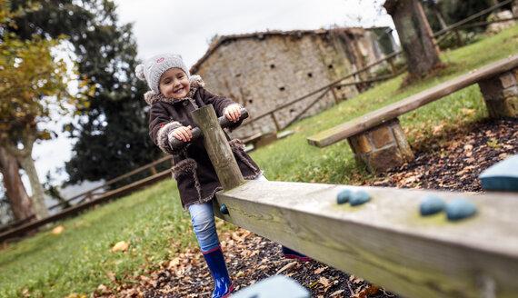 Little girl having fun on a rocker  in autumn - MGOF001241