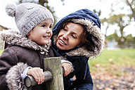 Portrait of happy little girl with her mother on a playground in autumn - MGOF001244