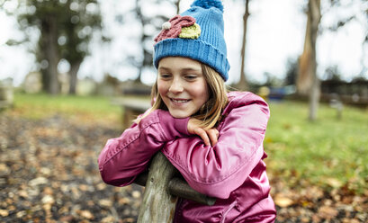Portrait of happy girl on a playground in autumn - MGOF001250