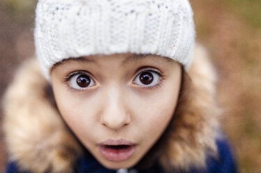 Portrait of little girl with eyes wide open - MGOF001253