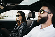 Young couple driving in a car - JRFF000322