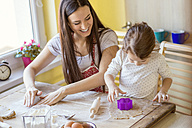Mother and her little daughter baking together - HAPF000146
