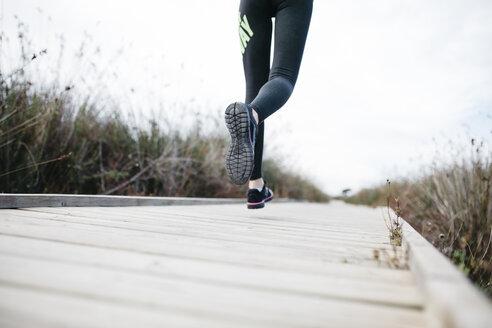 Spain, Tarragona, Woman running on a catwalk - JRFF000335