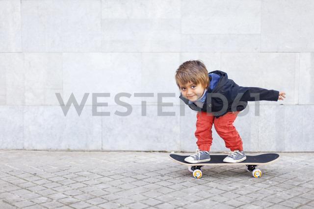 Portrait of little boy balancing on skateboard - VABF000053
