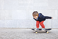 Portrait of little boy balancing on skateboard - VABF000053