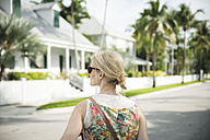 USA, Florida, Key West, woman on street looking around - CHPF000206