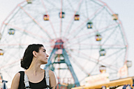 USA, New York, Coney Island, young woman at the amusement park - GIOF000675