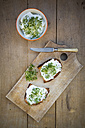 Slice of toasted  bread with organic curd and cress - LVF004440