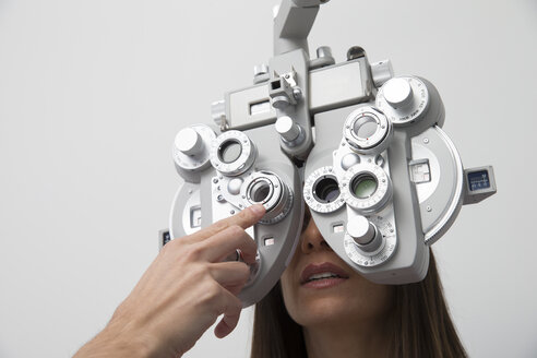 Woman at the optometrist making an eye test - ERLF000112