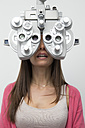 Woman at the optometrist making an eye test - ERLF000115