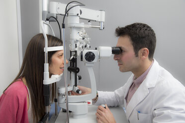 Woman at the optometrist making an eye test - ERLF000118