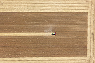 Aerial view of combine harvester in field - KLE000038