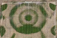 Aerial view of wet soccer field, irrigation system during extreme dryness - KLEF000044