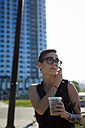 USA, New York City, Brooklyn, portrait of tattooed young woman with cold drink - GIOF000689