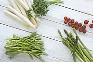 White, green and wild asparagus, parsley and cherry tomatoes on wood - ASF005807