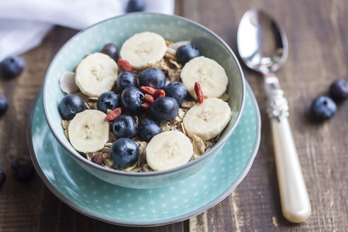 Bowl of blueberry muesli with wolfberries and banana slices - SARF002474