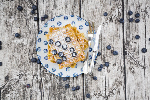 Plate of waffles with icing sugar and blueberries - LVF004453