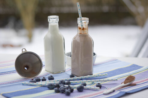 Two glass bottles of milk and cocoa - YFF000517