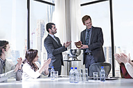 Successful business people celebrating awards in boardroom - ZEF008013