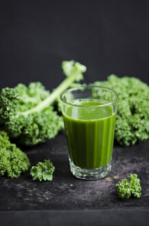Glass of kale smoothie with different fruits - CZF000242