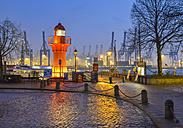 Germany, Hamburg, Harbor, Oevelgoenne, Lighthouse in the evening - RJF000564