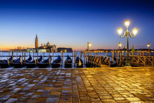 Italy, Veneto, Venice, gondolas in front of San Giorgio Maggiore at dusk - HAMF000129