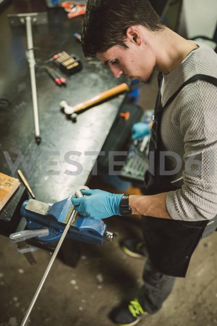 Young mechanic working in repair garage - RAEF000794