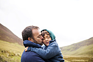 UK, Bala, father and son hugging each other - VABF000087
