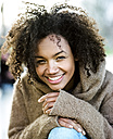 Portrait of smiling young woman with afro - MADF000782