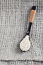 Wooden spoon of quinoa on cloth - MYF001328