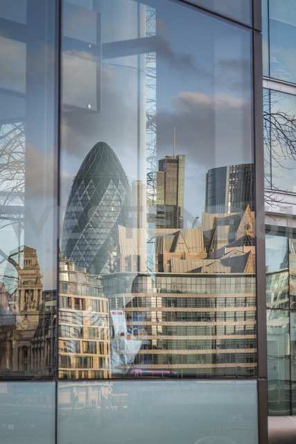 UK, London, Swiss Re Tower and other buildings mirroring in a windowpane - NKF000435