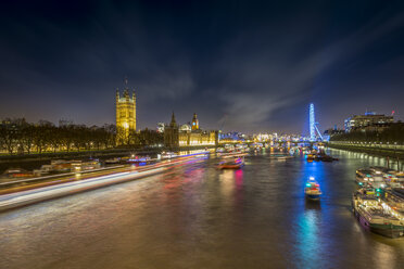 UK, London, view to River Thames with Palace of Westminster and London Eye at night - NKF000441