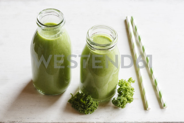 Two glass bottles of kale smoothie - EVGF002783