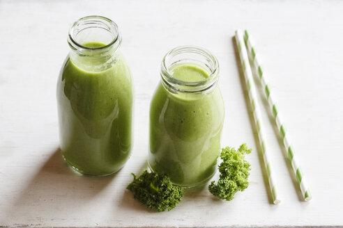 Two glass bottles of kale smoothie - EVGF002783