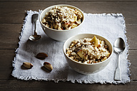 Two bowls of vegan quinoa porridge with apple and pecan - EVGF002786
