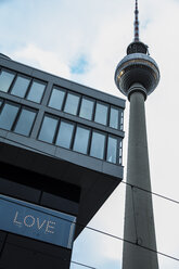 Germany, Berlin, view to television tower and building with the word 'Love' - NGF000242